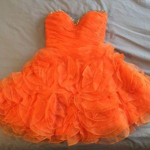Orange knee-length prom dress